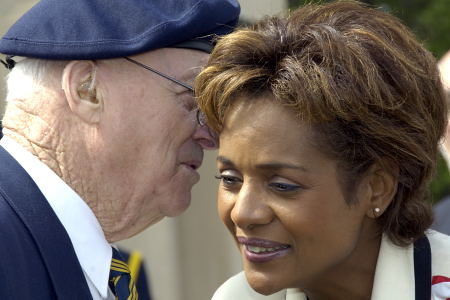 Her Excellency the Right Honourable Michaëlle Jean, Governor General of Canada, shares a word with a war veteran during a walkabout in the Queen Elizabeth Gardens outside Saskatchewan's Legislative Assembly in Regina on May 8, 2006. The Governor General conducted her first regional visit to Saskatchewan from May 8 to 10, 2006. During her three-day visit, Her Excellency focused on activities that empowered groups of diverse backgrounds, from youth and First Nations to residents of North Central Regina's inner city, to be heard. This was her 8th provincial visit since the beginning of her mandate.