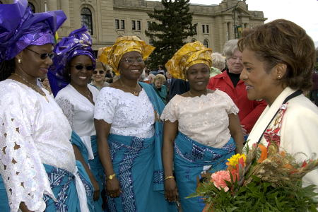 Her Excellency the Right Honourable Michaëlle Jean, Governor General of Canada, takes time to meet people from Saskatchewan during a walkabout in the Queen Elizabeth Gardens outside Saskatchewan's Legislative Assembly in Regina on May 8, 2006. The Governor General conducted her first regional visit to Saskatchewan from May 8 to 10, 2006. During her three-day visit, Her Excellency focused on activities that empowered groups of diverse backgrounds, from youth and First Nations to residents of North Central Regina's inner city, to be heard. This was her 8th provincial visit since the beginning of her mandate.