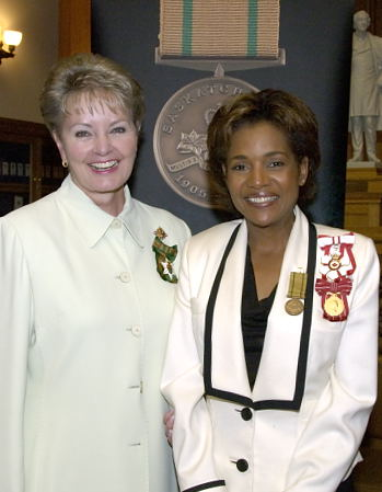 Her Excellency the Right Honourable Michaëlle Jean, Governor General of Canada, poses with Her Honour the Honourable Dr. Lynda Haverstock, Lieutenant Governor of Saskatchewan, after being presented with the Saskatchewan Centennial Medal inside the Saskatchewan Legislature in Regina on May 8, 2006. The Governor General delivered an address to members of the Legislative Assembly and the people of Saskatchewan. The Governor General conducted her first regional visit to Saskatchewan from May 8 to 10, 2006. During her three-day visit, Her Excellency focused on activities that empowered groups of diverse backgrounds, from youth and First Nations to residents of North Central Regina's inner city, to be heard. This was her 8th provincial visit since the beginning of her mandate.