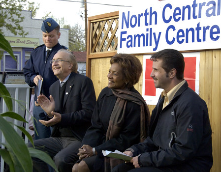 Their Excellencies the Right Honourable Michaëlle Jean, Governor General of Canada, and Mr. Jean-Daniel Lafond, together with His Worship Pat Fiacco, Mayor of Regina, enjoy a performance during a community reception at the North Central Community Centre in Regina, Saskatchewan, on May 9, 2006. The reception followed the Governor General's walking tour of North Central Regina. The Governor General visited the homes of some of the people in this sector, which is being revitalized by an innovative partnership between the three levels of government and community associations.