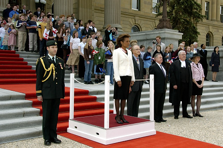 Her Excellency the Right Honourable Michaëlle Jean, Governor General of Canada, listens to the viceregal salute during a welcoming ceremony outside the Legislative Assembly in Edmonton, Alberta, on May 4, 2006. The Governor General conducted her first regional visit to Alberta from May 4 to 6, 2006. During her three-day visit, Her Excellency focused on building dialogue and forging links with as many Albertans as possible, including the military and their spouses, school children and youth, as well as community volunteers. This was her 7th provincial visit since the beginning of her mandate.