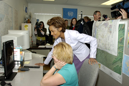 Her Excellency the Right Honourable Michaëlle Jean, Governor General and Commander-in-Chief of Canada, joins in an impromptu videophone conversation with Master Corporal Christian Montvert based in Kandahar, Afghanistan, and his wife Rachelle Montvert (seated) at the Military Family Resource Centre in Edmonton, Alberta. The May 4 visit to the Canadian Forces Base in Edmonton was part of the Governor General's first official visit to Alberta, from May 4 to 6, 2006. During her three-day visit, Her Excellency focused on building dialogue and forging links with as many Albertans as possible, including the military and their spouses, school children and youth, as well as community volunteers. This was her 7th provincial visit since the beginning of her mandate.