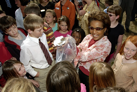 Her Excellency the Right Honourable Michaëlle Jean, Governor General of Canada, shows one of the school's findings at an archeological dig at Millarville Community School in Millarville, Alberta, on May 5, 2006. Her Excellency also visited some classes with her daughter Marie‑Éden and addressed the children in the school's gymnasium. At the end of her visit, the Governor General took a group photo with students in the school's playground. The visit to Millarville Community School was in response to 75 personal invitations that the Governor General received from students to visit their school and their community, as well as their archeological dig. In 2005, Ms. Loretta Stabler and Ms. Patti Thorne, teachers at the school, received the Governor General's Award for Excellence in Teaching Canadian History from Governor General Jean. In 2003, Millarville school teacher Pam Irving had also received this award from the Right Honourable Adrienne Clarkson, the former governor general.