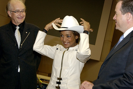 "Her Excellency the Right Honourable Michaëlle Jean, Governor General of Canada, ""white-hatted"" by His Worship Dave Bronconnier, Mayor of Calgary, during an official welcoming ceremony at City Hall on May  6, 2006. The Governor General conducted her first regional visit to Alberta from May 4 to 6, 2006. During her three-day visit, Her Excellency focused on building dialogue and forging links with as many Albertans as possible, including the military and their spouses, school children and youth, as well as community volunteers. This was her 7th provincial visit since the beginning of her mandate."