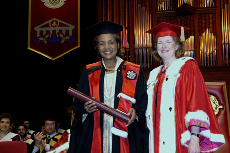 Her Excellency the Right Honourable Michaëlle Jean, Governor General of Canada, receives an honorary doctorate from the Faculty of Arts of the University of Ottawa on June 5, 2006 at the National Arts Centre. The Governor General, pictured here with the university's chancellor, Huguette Labelle, delivered the keynote address during the spring convocation ceremony.  It was the first honorary doctorate conferred upon the Governor General.