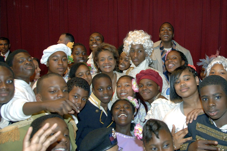 The Governor General poses with students from Lawrence Heights Middle School in Toronto on June 14, 2006, after the theatrical performance of <b><i>An Ode to Madame G.G.</i></b>  Her Excellency was invited by Principal Janice Searles, Terrance A. Saunders, grade 6 and drama teacher, and by the staff and students from the school, to attend the play inspired by her life. The Governor General spoke to the students after the play, which was created and directed by Mr. Saunders.