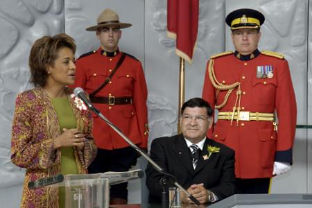 Her Excellency the Right Honourable Michaëlle Jean, Governor General of Canada and His Excellency Jean-Daniel Lafond are greeted inside the Legislative Chamber on June 19, 2006. The Governor General delivered an address to the members of the Legislative Assembly and to the people of the Northwest Territories while in the chamber. Following her speech, Her Excellency presented the official registration document of the Northwest Territories' coat of arms to the Premier.  Their Excellencies then planted a tree outside the legislative assembly to commemorate their official visit to the territory.
