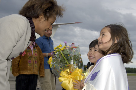 The Governor General stops to chat with young girls upon her arrival in Fort Simpson, Northwest Territories, on June 21, 2006.   Their Excellencies celebrated National Aboriginal Day in Fort Simpson.  During their time in the community, they took part in a fire ceremony, a tour of the town, a meeting with local leaders, elders and first nations groups, as well as a community feast.
