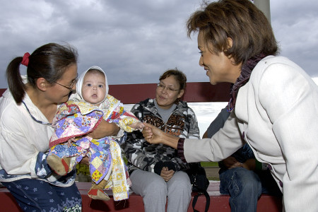 Her Excellency the Right Honourable Michaëlle Jean, Governor General of Canada, takes time to talk with residents from the community at a fire ceremony in Fort Simpson, Northwest Territories, on June 21, 2006.  Their Excellencies celebrated National Aboriginal Day in Fort Simpson.  During their time in the community, they also took part in a tour of the town, a meeting with local leaders, elders and first nations groups, as well as a community feast.