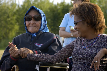 Her Excellency the Right Honourable Michaëlle Jean, Governor General of Canada, takes time to talk with residents such as Elders and children at a community feast in Fort Simpson, Northwest Territories, on June 21, 2006.  Their Excellencies celebrated National Aboriginal Day in the community.  During their time in the town, they also took part in a fire ceremony, a tour of the community, as well as a meeting with local leaders, elders and first nations groups.