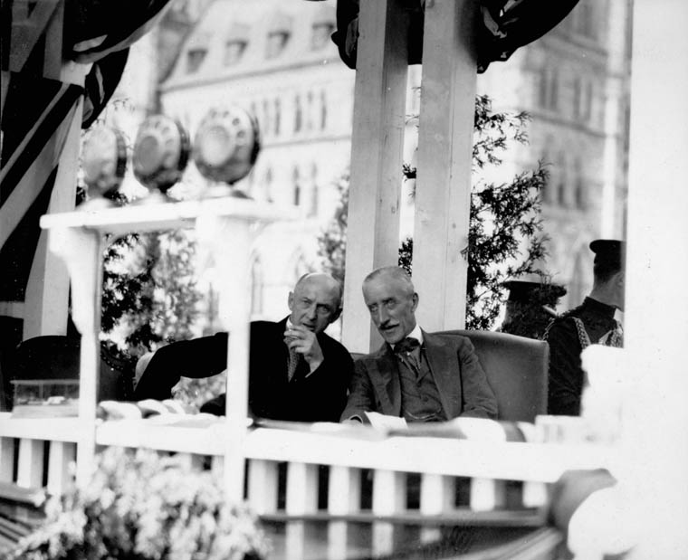 Viscount Willingdon (right) and the Honourable J.C. Elliott (left) at a ceremony celebrating the Diamond Jubilee of Confederation.  Date: July 1927. Photographer: Unknown. Reference: Library and Archives Canada, PA-027554.