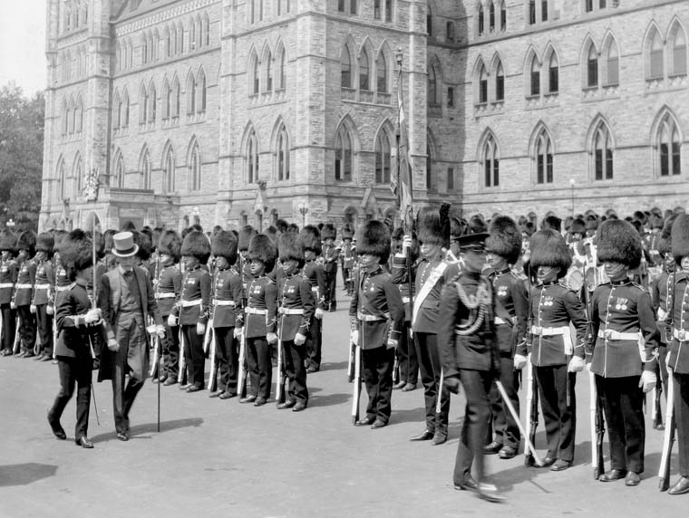 Viscount Willingdon, Governor General of Canada (1926-1931), inspects the Governor General's Foot Guards, on Parliament Hill.  Date: July 1927. Photographer: Unknown. Reference: Library and Archives Canada, PA-027578.