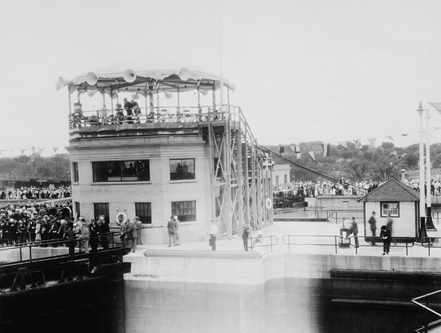 The Earl of Bessborough, Governor General of Canada (1931-1935), operates a control to Lock 6 during the official opening of the Welland Canal, in Ontario.  Date: August 6, 1932. Photographer: Unknown   Reference: Library and Archives Canada, C-045308.