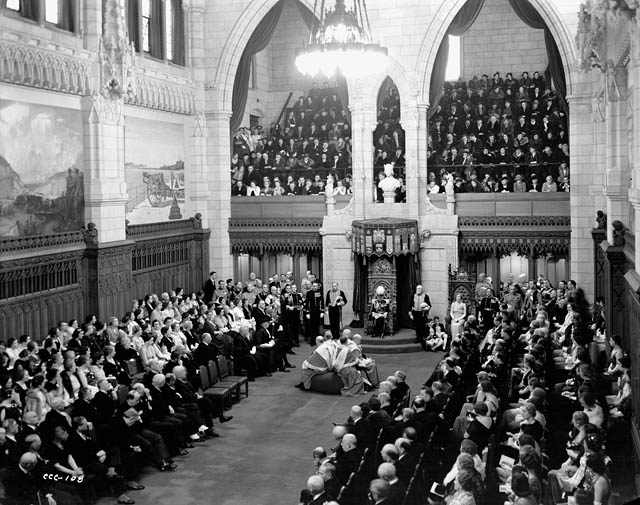 Lord Tweedsmuir, Governor General of Canada (1935-1940), reads the Speech from the Throne. Date: January 27, 1938. Photographer: National Film Board of Canada. Reference: Library and Archives Canada, PA-801226.