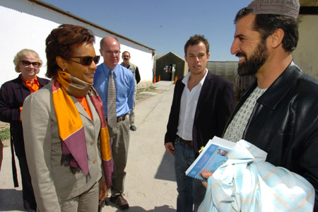 Her Excellency the Right Honourable Michaëlle Jean, Governor General of Canada, share a light moment with Abdul Baqi Popal, from UN-Habitat, prior to a working lunch at Camp Nathan Smith with various representatives of non-governmental organizations working in Kandahar Province.