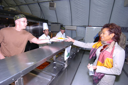 Master Corporal Pascal Mercier, a Canadian Forces cook based in Camp Nathan Smith, serves lunch to Her Excellency the Right Honourable Michaëlle Jean, Governor General of Canada.