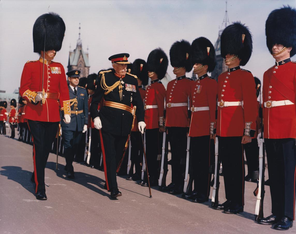 Governor General Georges P. Vanier inspects the Guard of Honour before the opening of Parliament. Date: April 5, 1965. Photographer: Department of National Defence. Reference: PCN 5460.