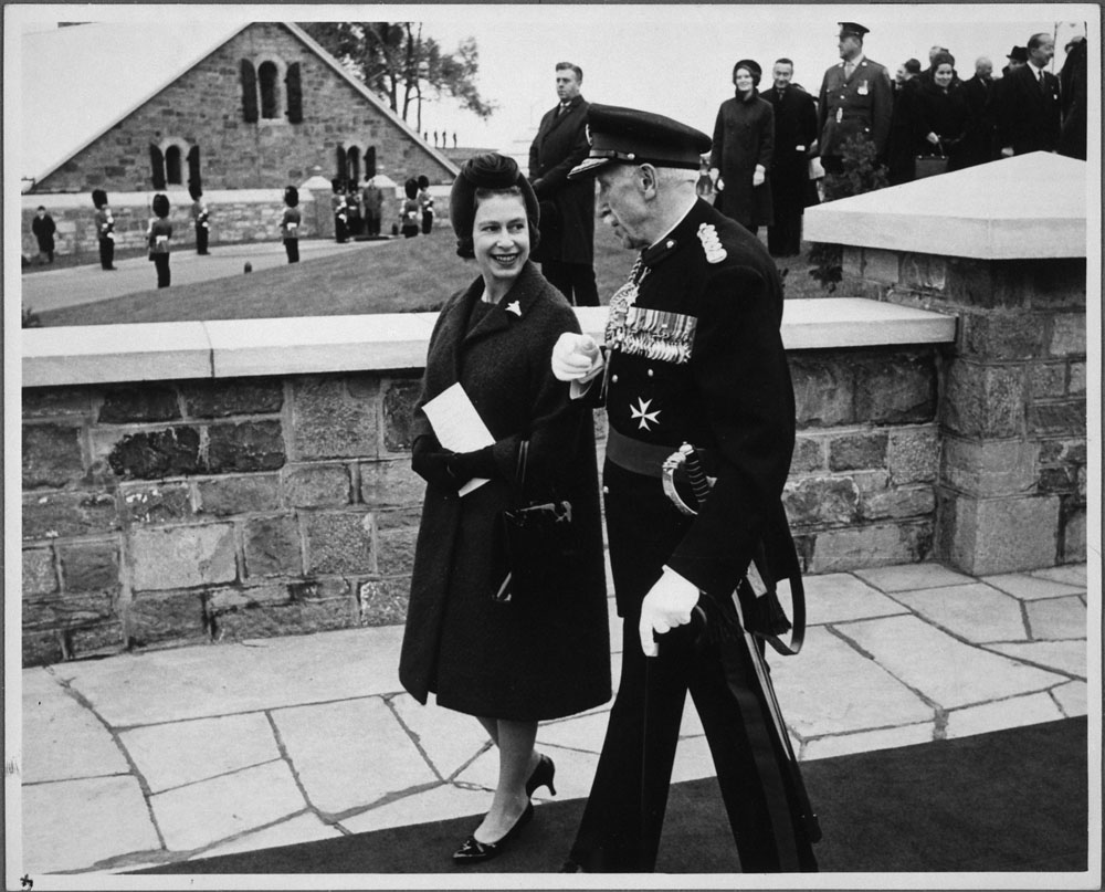 Her Majesty Queen Elizabeth II and Governor General Georges P. Vanier, at the Citadelle of Québec. Date: October 1964. Photographer: Unknown. Reference: Library and Archives Canada, C-056999.