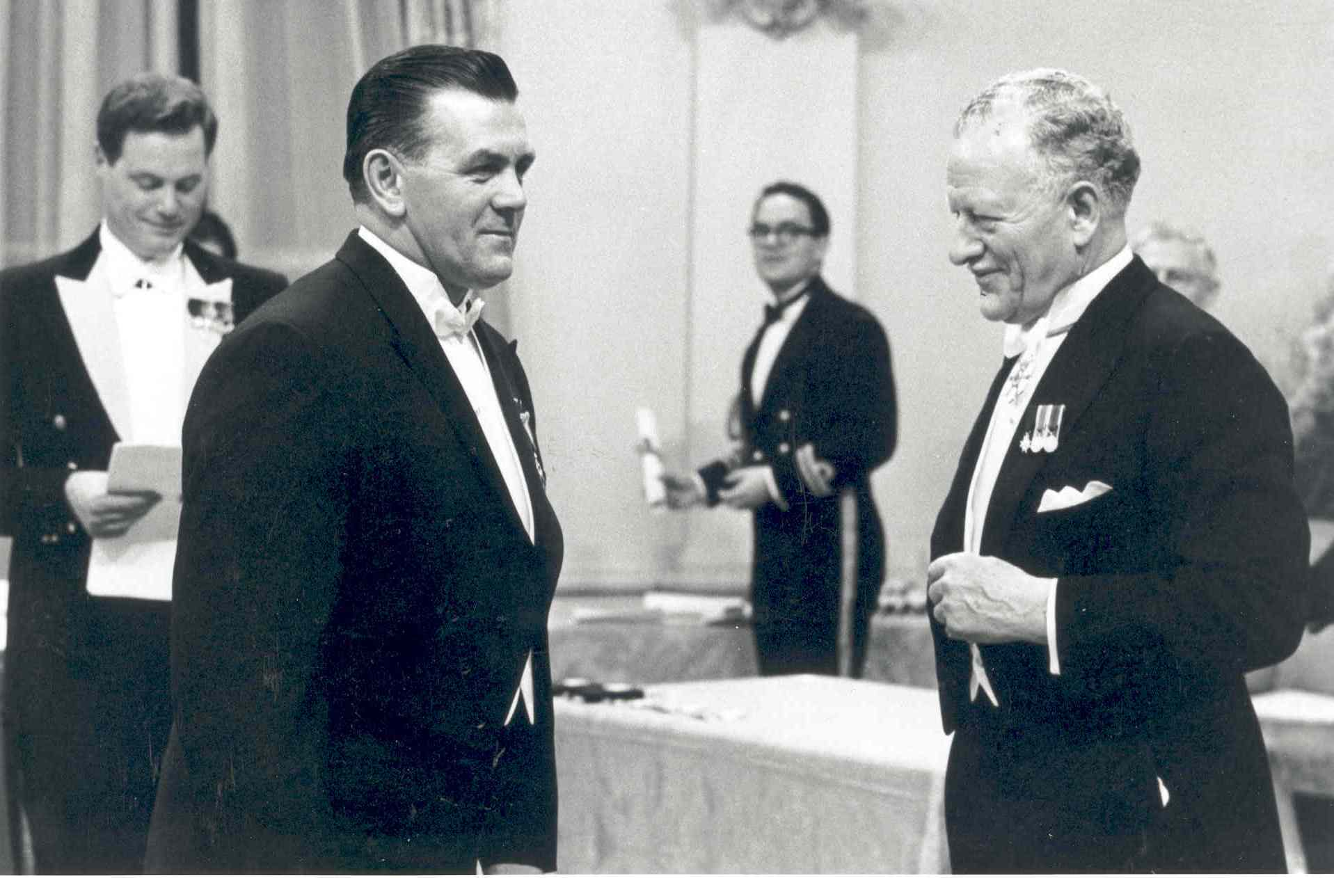 Governor General Roland Michener invests hockey great Maurice Richard in the Order of Canada. Date: November 24, 1967. Photographer: National Film Board of Canada. Reference: Library and Archives Canada, PA-211754.