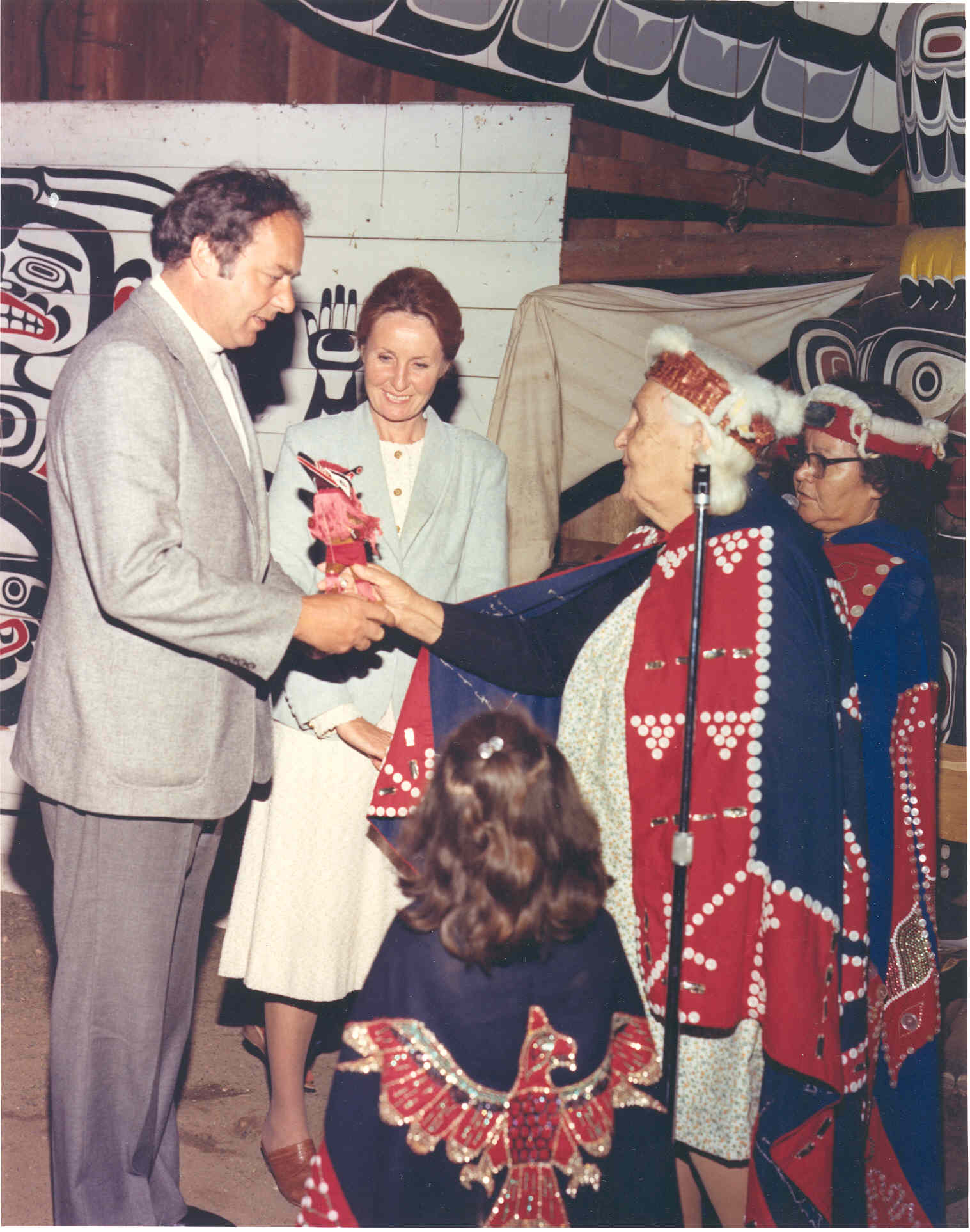 Governor General Edward Schreyer is greeted by a Kwakiutl elder, in Alert Bay, British Columbia.  Date: July 10, 1980. Photographer: Department of national Defence. Reference: ETC80-2017.