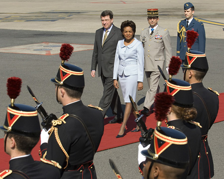 The Governor General reviews the guard of honour upon arrival at the Paris-Orly airport in Paris, France .