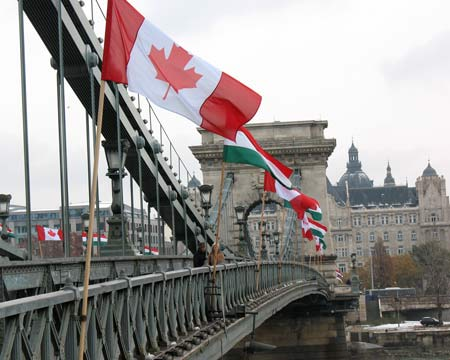 Flags from Canada and Hungary are flown on the Chain Bridge located in the heart of Budapest.
