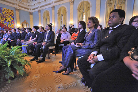 The Governor General and the participants to the Youth Dialogue watch the US presidential inauguration ceremony.