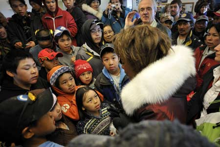 Inside the airport, the Governor General received a warm welcome from youth from the Pond Inlet community.