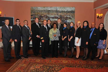 Capt. James Murphy the pilot of CanJet Flight 918 and Crew with the Governor General and CanJet representatives.