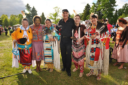 Their Excellencies with community members of Mashteuiatsh dressed in traditional costumes.