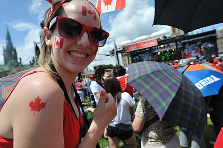 Canadian spirit was lively on Confederation Day as Noon show spectators proudly wore the red and white colours.