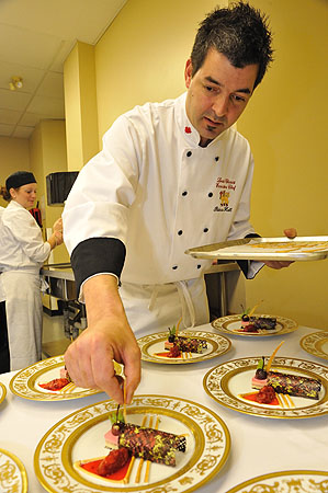 In preparation for the State Dinner, Executive Chef Louis Charest adds the finishing touches to his masterpiece.