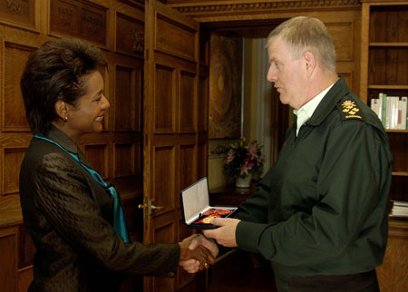 General Rick J. Hillier, C. M. M., C. S. M., C. D., Chief of the Defence Staff, presented the Canadian Forces' Decoration to Her Excellency the Right Honourable Michaëlle Jean, C.C., C.M.M., C.O.M., C.D., Governor  General and Commander-in-Chief of Canada, during a ceremony at Rideau Hall on October 21, 2005. Introduced in 1951, the Canadian Forces' Decoration is presented to each new governor general as the Commander-in-Chief of Canada.
