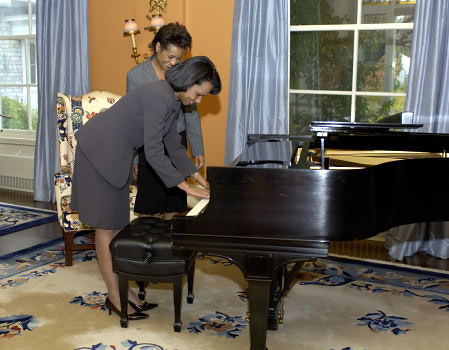 Her Excellency the Right Honourable Michaëlle Jean, Governor General of Canada, and the Honourable Dr. Condoleezza Rice, Secretary of State of the United States of America, pause in front of Glenn Gould's practice piano at Rideau Hall. Dr. Rice and the Governor General met privately on Tuesday, October 25, 2005.