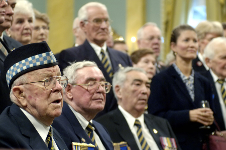 A group of Veterans listen to remarks by Her Excellency the Right Honourable Michaëlle Jean, Governor General and Commander-in-Chief of Canada and patron of the Royal Canadian Legion, during the launch of the 2005 Poppy & Remembrance campaign on Tuesday, October 25, 2005, at Rideau Hall.  The Governor General spoke of the freedom we enjoy and the price paid by our fellow Canadians who fought to preserve it.