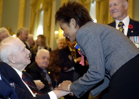 Her Excellency the Right Honourable Michaëlle Jean, Governor General and Commander-in-Chief of Canada and patron of the Royal Canadian Legion, talks with Ernie Steeves during the launch of the 2005 Poppy & Remembrance campaign, on Tuesday, October 25, 2005, at Rideau Hall.