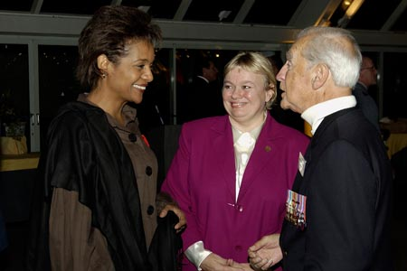 Her Excellency, The Right Honourable Michaëlle Jean, Governor General and Commander-in-Chief of Canada, speaks with the Honourable Albina Guarnieri, Minister of Veterans Affairs and Mr. Joseph Clement during a dinner with the Aboriginal Veterans Delegation of the Spiritual Journey in Touques, France on October 29th, 2005.