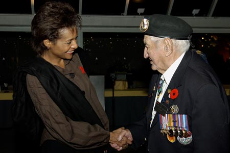 Her Excellency, The Right Honourable Michaëlle Jean, Governor General and Commander-in-Chief of Canada, speaks with Grand Chief and second world war veteran Howard Anderson the Honourable Albina Guarnieri, Minister of Veterans Affairs and Mr. Joseph Clement during a dinner with the Aboriginal Veterans Delegation of the Spiritual Journey in Touques, France on October 29th, 2005.