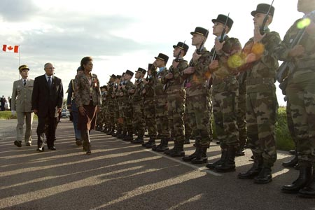 <p>Her Excellency, The Right Honourable Michaëlle Jean, Governor General and Commander-in-Chief of Canada participating in the Remembrance Ceremony at the Bény-sur-Mer Canadian War Cemetery in Normandy, France on October 30th, 2005. This commemorative ceremony honoured First Nations, Métis and Inuit Canadian who died serving their country in times of war.</p>