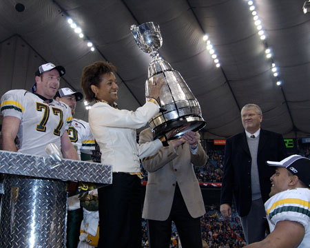 Her Excellency the Right Honourable Michaëlle Jean, Governor General of Canada, lifts the Grey Cup before handing it to the winning team, the Edmonton Eskimos. The game was held in Vancouver, British Columbia, on November 27th, 2005.