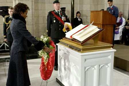 Her Excellency the Right Honourable Michaëlle Jean, Governor General and Commander-in-Chief of Canada, lays a wreath during the installation ceremony of the Seventh Book of Remembrance titled In the Service of Canada, on November 11, 2005, in Ottawa. This book contains the names of members of the Canadian Forces who have lost their lives in the line of duty since October 1, 1947.
