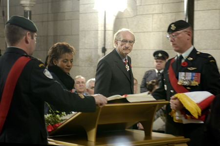 Their Excellencies the Right Honourable Michaëlle Jean, Governor General and Commander-in-Chief of Canada, and Mr. Jean Daniel Lafond during the installation ceremony of the Seventh Book of Remembrance titled In the Service of Canada, on November 11, 2005, in Ottawa. This book contains the names of members of the Canadian Forces who have lost their lives in the line of duty since October 1, 1947.