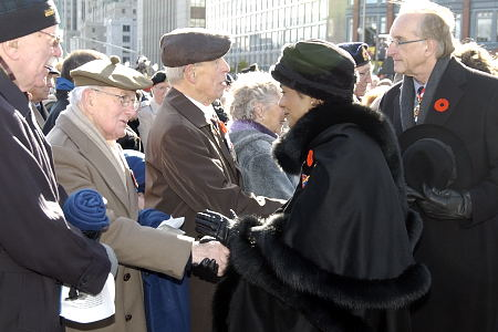 Their Excellencies the Right Honourable Michaëlle Jean, Governor General and Commander-in-Chief of Canada, and Mr. Jean Daniel Lafond shake hands with veterans during the National Remembrance Day Ceremony at the National War Memorial in Ottawa, on November 11, 2005.