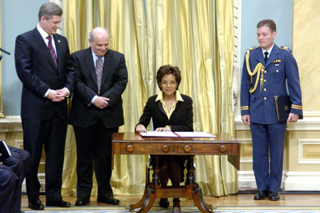 Her Excellency the Right Honourable Michaëlle Jean, Governor General of Canada, signs official documents during the swearing-in ceremony of the 22nd prime minister of Canada and the 28th ministry, on February 6, 2006, at Rideau Hall.