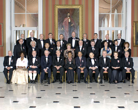 The Governor General, who is Chancellor and Principal Companion of the Order, presented 32 recipients with their insignia of membership during an investiture ceremony at Rideau Hall. She is surrounded here by one Companion, 10 Officers and 21 Members who were invested on Friday, February 17, 2006.