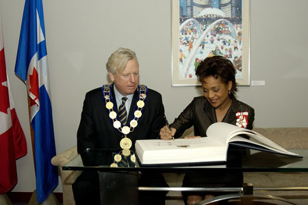 Her Excellency the Right Honourable Michaëlle Jean, Governor General of Canada, signs the distinguished guest book during her visit with His Worship David Miller, Mayor of Toronto, during her visit to Toronto on February 21, 2006.