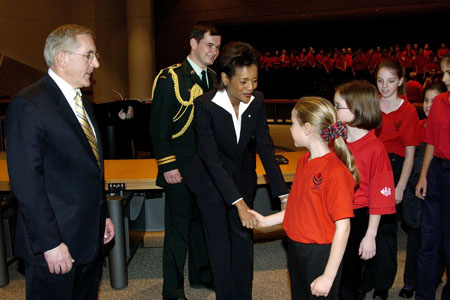 Her Excellency the Right Honourable Michaëlle Jean, Governor General of Canada, shakes hands with children during her Civic Call to the City of Ottawa on December 1, 2005, at City Hall.