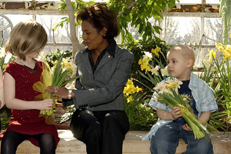 The Right Honourable Michaëlle Jean, Governor General, receives daffodils from Hannah Billings (left) and Keanon Saleh-Basha (right) on March 28, 2006, in the greenhouse of Rideau Hall to kick off the Canadian Cancer Society's 2006 Daffodil Month. Both children have cancer and are part of this year's campaign to raise funds for cancer research. A symbol of hope, the daffodil has been part of the Society's annual fundraising campaign for nearly 50 years.