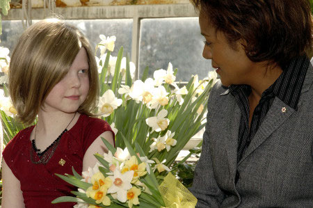 The Right Honourable Michaëlle Jean, Governor General, chats with cancer patient Hannah Billings, 9, during the launch of the Canadian Cancer Society's 2006 Daffodil Month on March 28, 2006 in the greenhouse at Rideau Hall. Hannah, 9, is part of this year's campaign to raise funds for cancer research. A symbol of hope, the daffodil has been part of the Society's annual fundraising campaign for nearly 50 years.