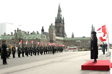 Governor General and Commander-in-Chief of Canada Michaëlle Jean listens to the Vice-Regal Salute and the 21-Gun Salute at the foot of the Peace Tower before inspecting the guard of honour on April 4, 2006. Governor General Jean then entered the Senate Chamber in Ottawa to deliver the Speech from the Throne that opened the first session of the 39<sup>th</sup> Parliament of Canada.